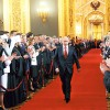 Putin walks as he attends inauguration ceremony at Kremlin in Moscow