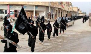 Isis fighters parade through Raqqa