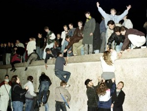 EAST GERMANS CLIMB THE BERLIN WALL