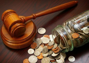 legal gavel and coins in a coin jar