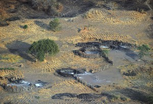 A photo taken on February 21, 2014 shows a compound with burnt tukuls (huts) at a village in Panyijiar county, Unity state, South Sudan. Thousands of Nuer tribes people are believed to have fled into the swamplands around Nyal district in Panyijiar after around 1,200 soldiers and a small army of young men swarmed, on February 7 to carry out a killing, looting and razing spree that left 60 dead and 26 wounded. In Panyjiar, an overwhelmingly Nuer area bordered by a Dinka majority, the only place to hide is the swamp, after a power struggle between leaders in the new nation's capital Juba in mid-December revived old ethnic tensions between South Sudan's largest Dinka tribe and secondary Nuer tribe. AFP PHOTO/Tony KARUMBA