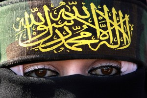 A Palestinian woman supporting Islamic Jihad attends a rally marking the 13th anniversary of the death of the group's leader Fathi Shekaki in Khan Younis refugee camp, southern Gaza Strip, Friday Oct. 24, 2008. Shekaki was shot and killed in a shooting attack in Malta in 1995. The group claims Israel was responsible for his death. (AP Photo/Adel Hana)