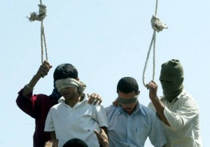 Blindfolded Mahmoud Asgari, 16, left, and another unidentified teenager are set to be publicly hanged, in Mashhad, Iran, on charges of raping boys in this photo taken on July 19, 2005. Nobel Peace laureate Shirin Ebadi Saturday condemned the execution of two under-18 boys in northeastern Iran, a punishment that has also reportedly prompted protests by gay groups around the world. (AP Photo)