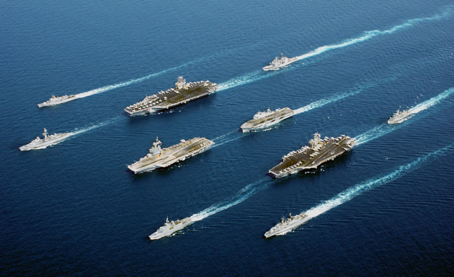 Naval vessels from five nations sail in parade formation for a rare photographic opportunity at sea. From top row left to right: the Italian Navy (Marina Militare) ship Maestrale Class Frigate MM MAESTRALE (F 570), French Navy Tourville Class Destroyer DE GRASSE (D 612), Nimitz Class Aircraft Carrier USS JOHN C. STENNIS (CVN 74), US Navy (USN) Ticonderoga Class Cruisers USS PORT ROYAL (CG 73), French Navy Charles de Gaulle Class Aircraft Carrier CHARLES DE GAULLE (R 91), Royal Navy Helicopter Carrier, Her MajestyÕs Ship (HMS) OCEAN (L 12), French La Fayette Class Frigate SURCOUF (F 711), Aircraft Carrier USS JOHN F. KENNEDY (CV 67), Netherlands Navy Karel Doorman Class Frigate Her MajestyÕs Netherlands Ship (Harer Majesteits) (HNLMS) VAN AMSTEL (F 831), Italian Navy De La Penne (ex-Animoso) Class Destroyer, MM LUIGI DURAND DE LA PENNE (ex Animoso) (D 560). The coalition forces are deployed in support of Operation ENDURING FREEDOM.