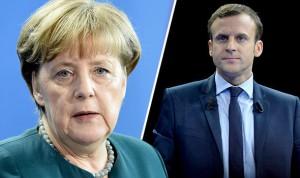 Macron-smiles-and-Merkel-coyly-grins-749522