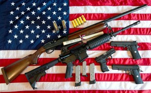 "This February 4, 2013 photo illustration in Manassas, Virginia, shows a Remington 20-gauge semi-automatic shotgun, a Colt AR-15 semi-automatic rifle, a Colt .45 semi-auto handgun, a Walther PK380 semi-auto handgun and various ammunition clips with a copy of the US Constitution on top of the American flag. US President Barack Obama Monday heaped pressure on Congress for action ""soon"" on curbing gun violence. Obama made a pragmatic case for legislation on the contentious issue, arguing that just because political leaders could not save every life, they should at least try to save some victims of rampant gun crime. AFP PHOTO/Karen BLEIER (Photo credit should read KAREN BLEIER/AFP/Getty Images)"