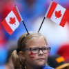 girl-celebrating-canada-day-canadian-flags-getty-420x315